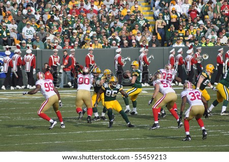 GREEN BAY, WI - NOVEMBER 22 : Green Bay Packers quarterback Aaron Rodgers drops back to pass in a game at Lambeau Field against the San Francisco 49ers on November 22, 2009 in Green Bay, WI