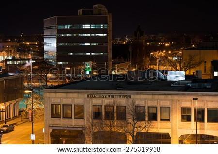 Green Bay, Wisconsin - March 9:  Downtown Green Bay view from parking structure shows a couple of buildings and streets illuminated on March 9, 2015. - stock photo