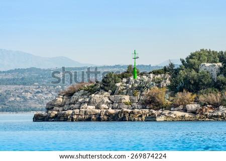 Green beacon on island - stock photo