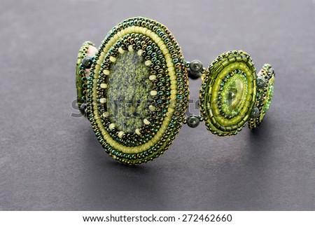 Green Beaded Bracelet with stones - stock photo