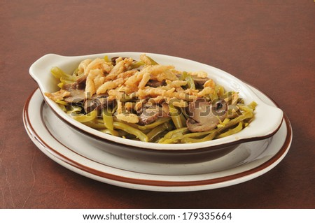 Green bean casserole with french fried onions and mushrooms - stock photo