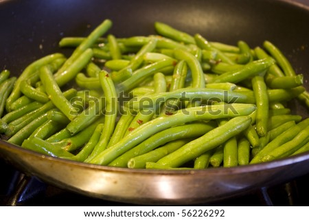 Green beans cooking in a skillet