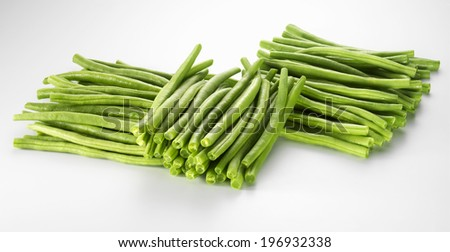 Green beans, cut, piled up, isolated on a white background - stock photo