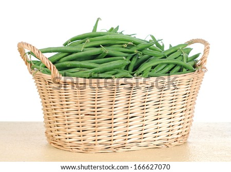 green beans from bamboo basket  - stock photo