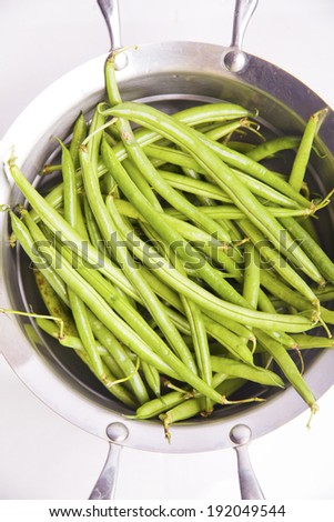 green beans in a saucepan on white - stock photo