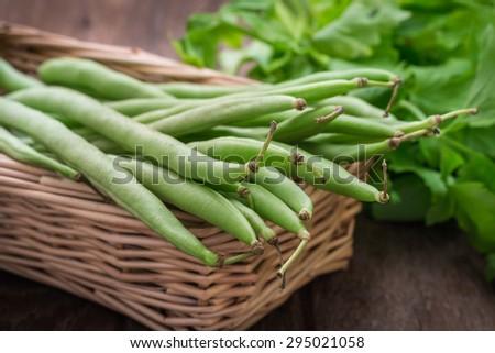 Green beans in wicker basket - stock photo