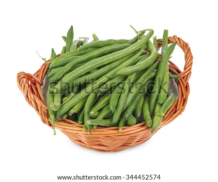 Green beans in wicker basket isolated on white background - stock photo