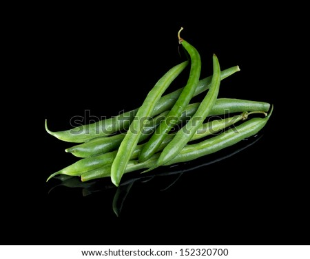 Green beans isolated on black background with reflection. - stock photo