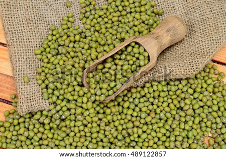 green beans mung on wooden table