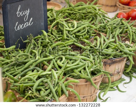 Green beans peppers at the local farmer's market. - stock photo