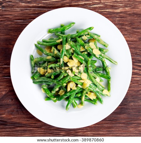 Green beans roasted in garlic and flaked almond - stock photo