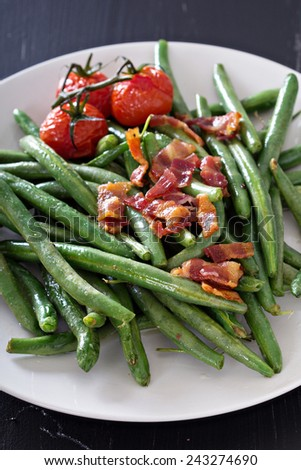 Green beans with bacon and tomatoes top view - stock photo