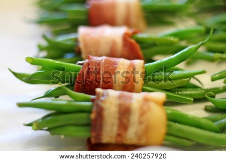 Green beans wrapped in bacon - stock photo