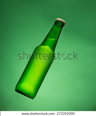 Green beer bottle in air. - stock photo