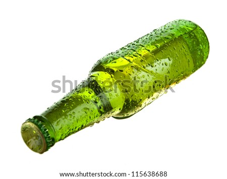 Green beer bottle lying  over white background - stock photo