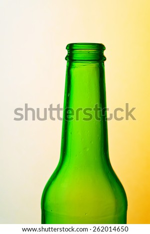 Green beer bottle with colorful background - stock photo
