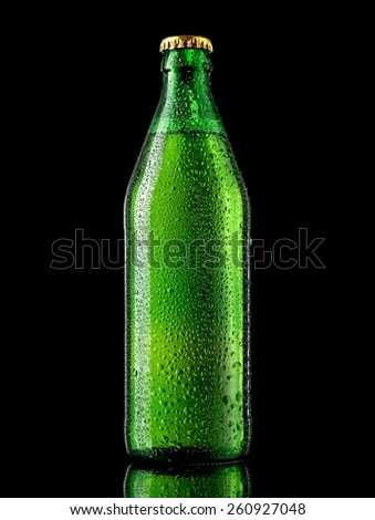 Green beer bottle with drops - stock photo