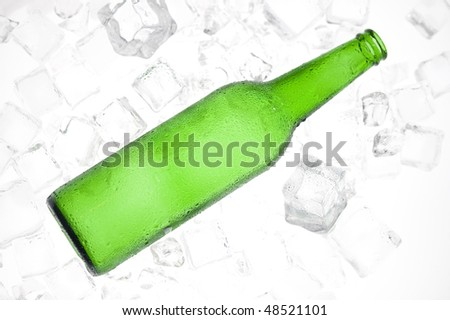 Green beer bottles and clear ice . Cider bottle