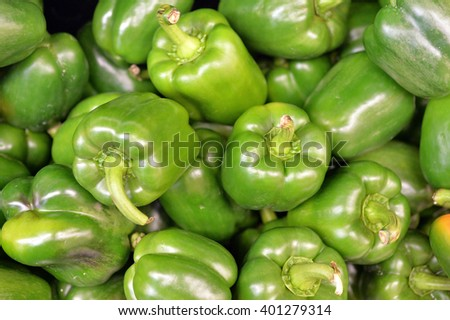 Green bell pepper heap in market good for food background