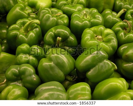 Green bell peppers on a bin. - stock photo
