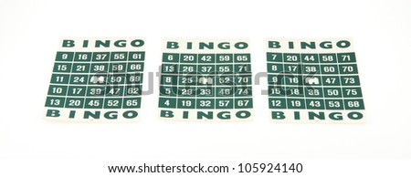 Green bingo cards isolated on a white background - stock photo