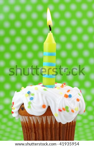 Green birthday candle on green background - stock photo