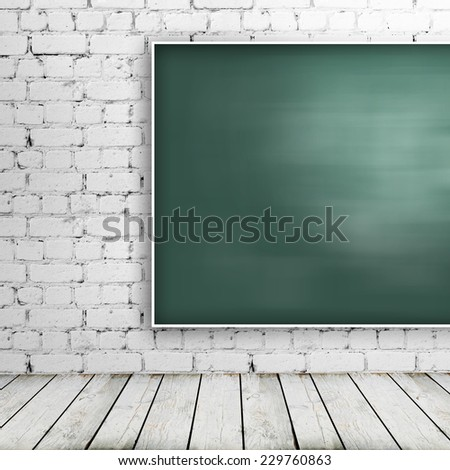 Green blackboard in brick room