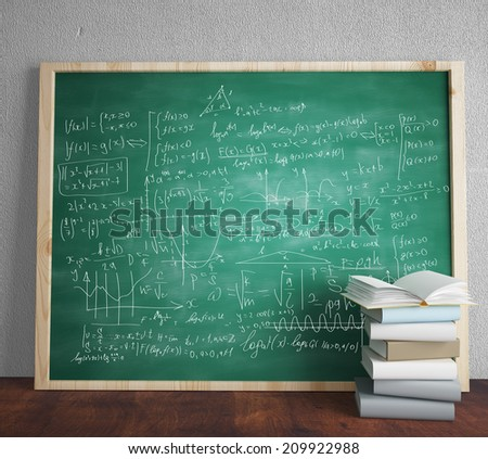 green blackboard with drawing mathematical formulas - stock photo