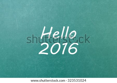 Green blackboard with hand written words note  Hello 2016 - stock photo