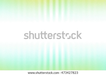 Green, blue and white blurred rays of light blend to create abstract background