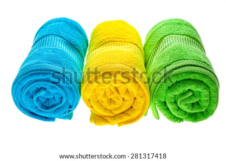 Green, blue and yellow towels isolated on white background. - stock photo
