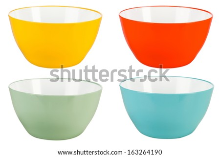 Green, blue, yellow, red plastic bowls isolated on white background - stock photo