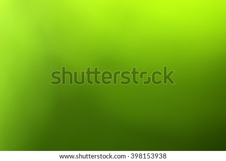 Green blurred background in sunlight - stock photo