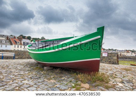 Green boat on display at La Salerie harbour, St Peter Port, Guernsey