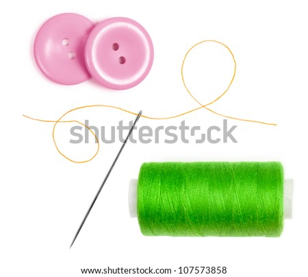 green bobbin thread with needle and pink buttons isolated on white - stock photo