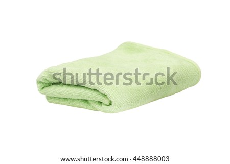 Green body towel isolated on white background.