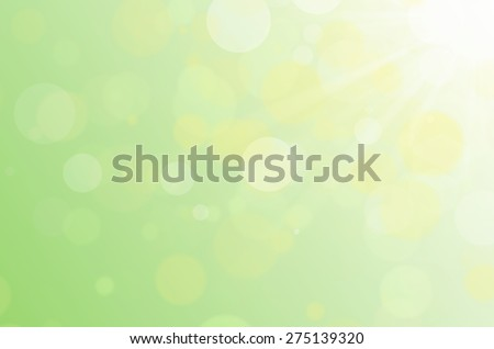 Green bokeh abstract background with sun flare. - stock photo