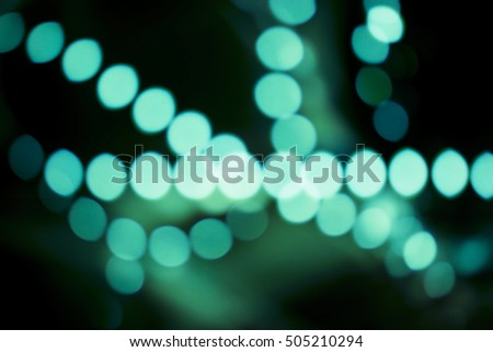 Green bokeh lights decoration on dark background