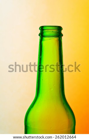 Green bottle against a colorful background - stock photo