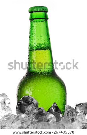green bottle of beer chilling on ice - stock photo
