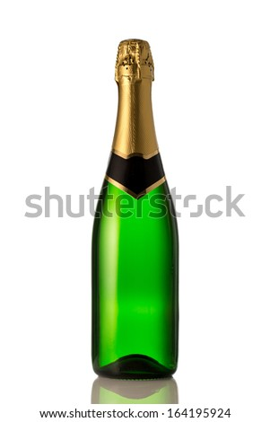 Green bottle of champagne in front of white background - stock photo