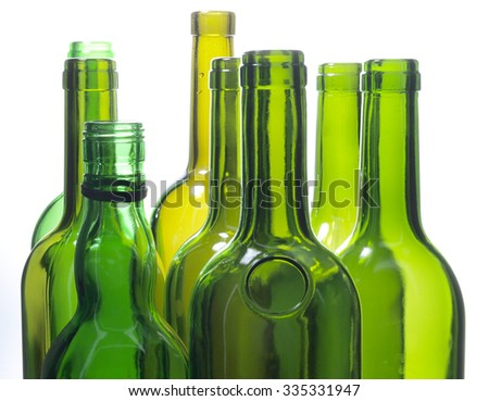 Green bottles and glasses on a white background