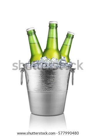 Green bottles of beer in ice bucket isolated on white background