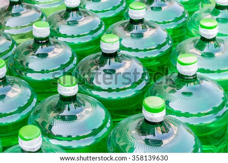 green bottles of water, abstract background