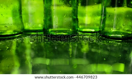 Green Bottles water reflection