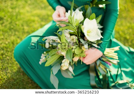 Green bouquet in hands of beautiful woman - stock photo