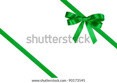 Green bow and two slanting ribbons against white. - stock photo
