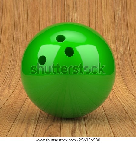 Green bowling ball on wooden background - stock photo