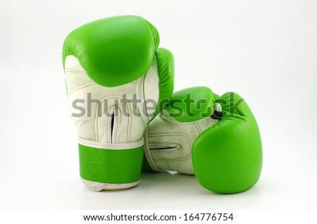 Green boxing gloves on a white background close up - stock photo
