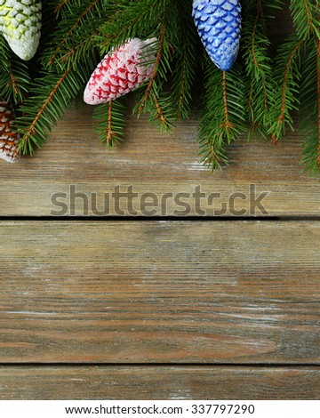 green branch and xmas decorations on boards - stock photo